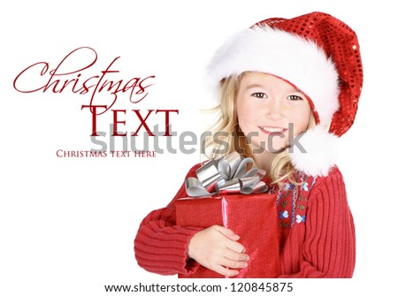 Child holding present wearing santa hat isolated on white