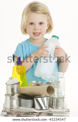 Child Holding Recycling - stock photo