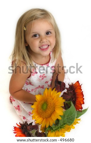 Child holding Sunflowers - stock photo