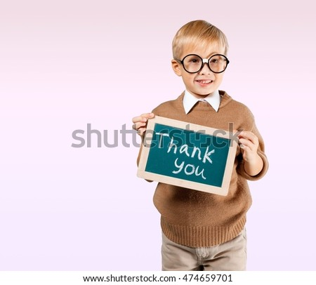 Child holding thank you board.