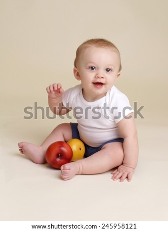 Child holdling an apple, baby eating and nutrition concept - stock photo