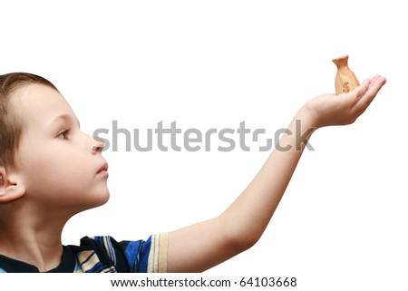 child holds a bag of money - stock photo