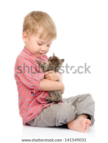 child hugging a kitten. isolated on white background - stock photo