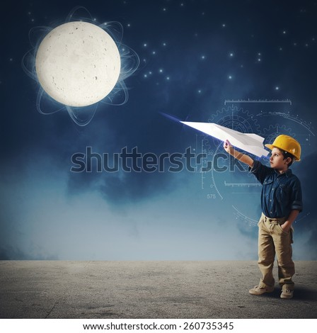 Child imagines launch a shuttle to moon - stock photo