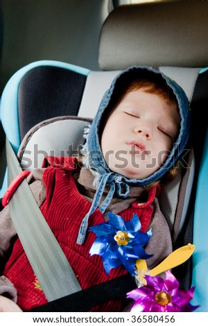 Child in a car - stock photo