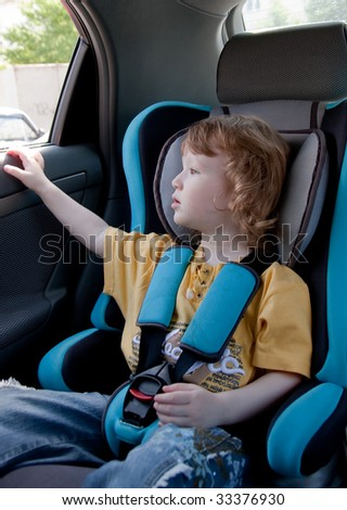 Child in a car. Traveling with comfort and safety - stock photo