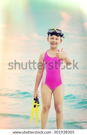child in a mask and flippers for diving - stock photo