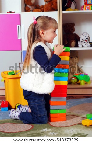 Child in a nursery built towers with blocks