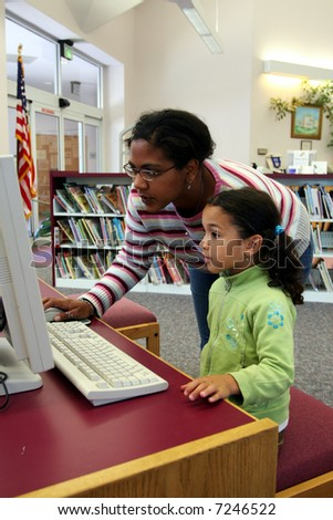 Child in a school library - stock photo