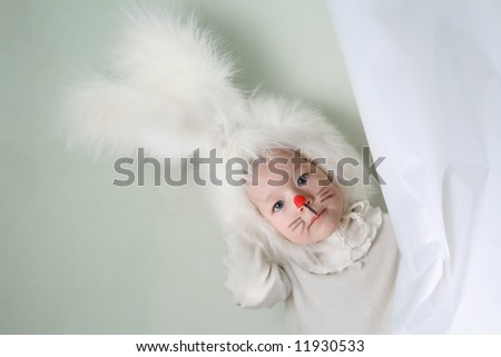 Child in a white downy bunny costume.