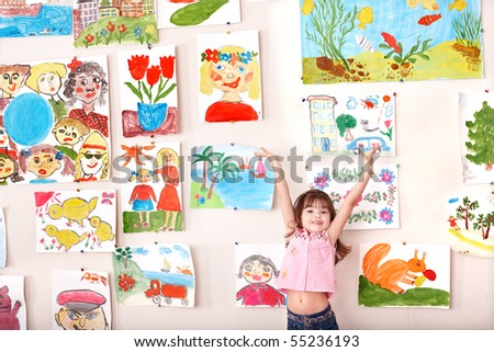 Child in art class with picture. Preschool. - stock photo