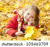 Child in autumn park. Outdoor. - stock photo