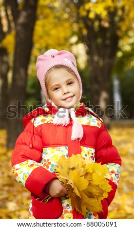 Child in autumn park. Outdoor.