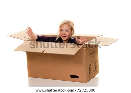Child in cardboard box. Is moving to box.