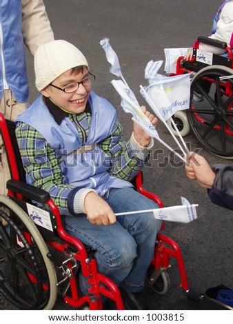 child in demonstration of disabled persons - stock photo
