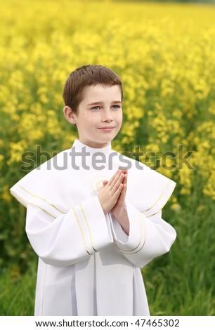 child in first holy communion, purity conscience, praying hands - stock photo