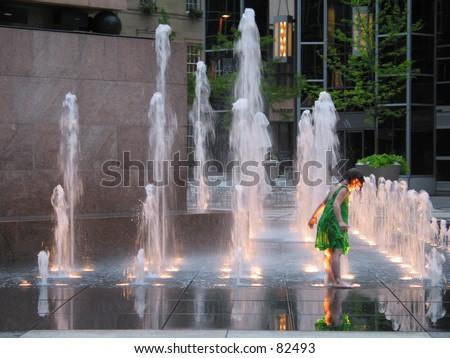Child in Fountain - stock photo