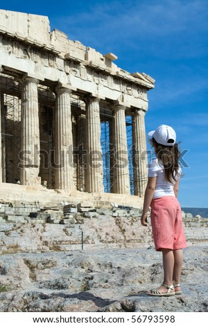Child in front of Facade of ancient temple Parthenon in Acropolis Athens Greece on the blue sky background - stock photo