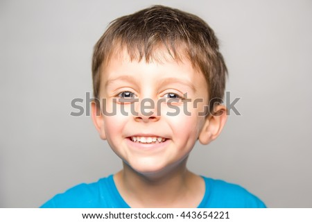 Child in joy smilling at camera - stock photo