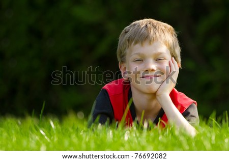 child in meadow - stock photo