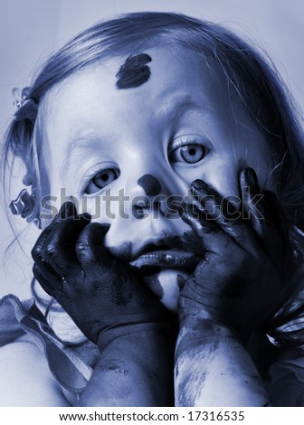 child in paint - stock photo