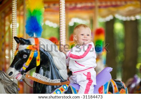 child in park of attractions - stock photo