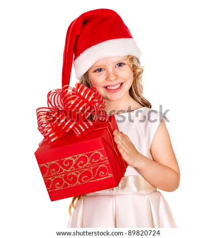 Child in Santa hat with gift box. Isolated. - stock photo