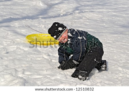Child in snowball fight in winter snow - stock photo