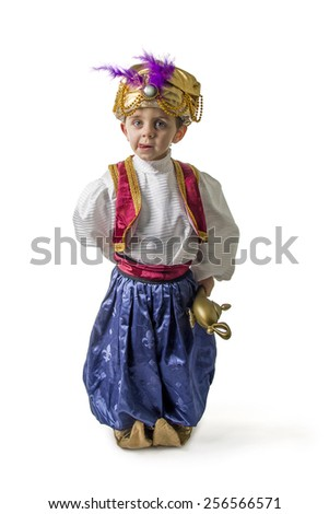 Child in sultan costume with lamp 