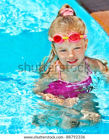 Child in swimming pool. Summer outdoor.