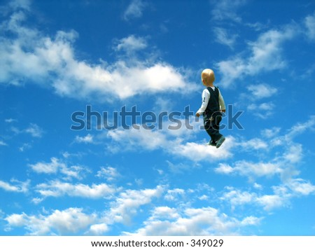 child in the clouds - stock photo