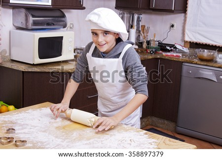 child in the kitchen making desserts