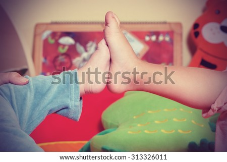 Child in the nursery play hide and seek  - stock photo