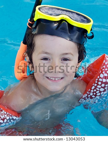 Child in the pool on holiday learning to swim - stock photo