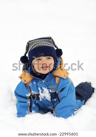 Child in the snow - stock photo