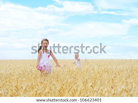 Child in wheat field - stock photo