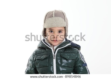 Child in winter clothes on white background
