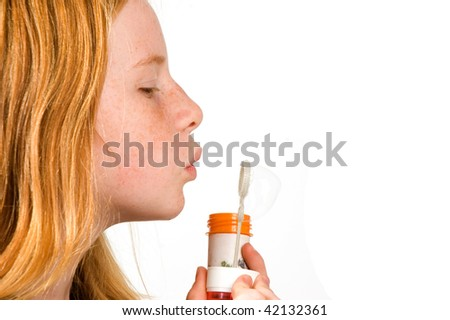 child is blowing bubbles isolated on white - stock photo
