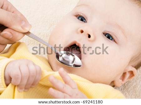 Child is drinking medicine syrup or water - stock photo