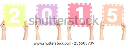 Child is holding number 2015, new year concept - stock photo