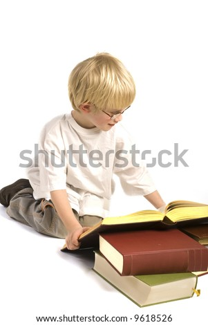 child is reading heavy books - stock photo