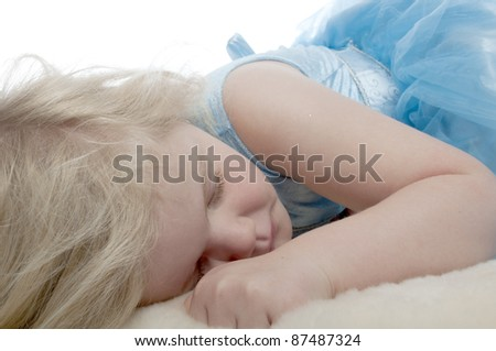 Child is sleeping dressed in a blue princess costume