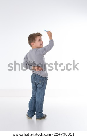 child is waiting for instructions before writing - stock photo