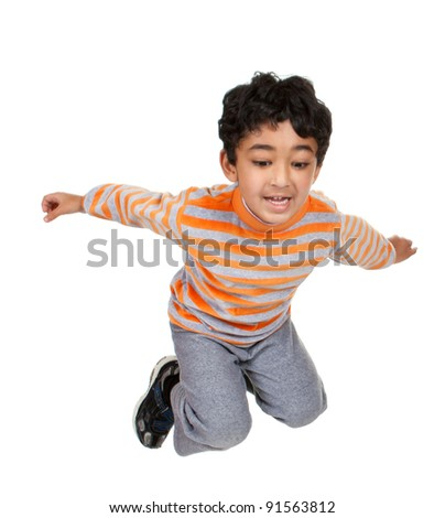 Child Jumping in the Air, Isolated, White - stock photo