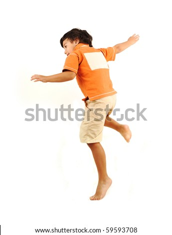 Child jumping on white background with copy space on his back - stock photo