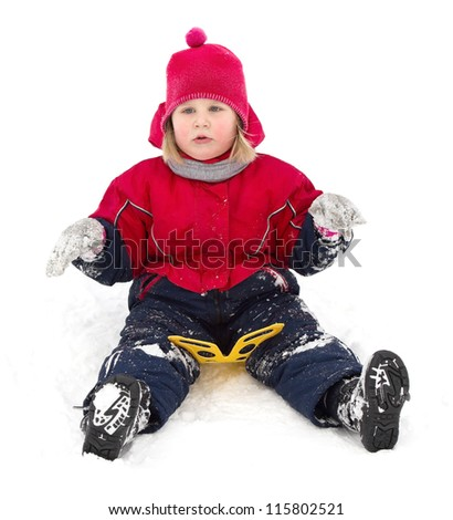 child just arrived after glide on snow hill - stock photo