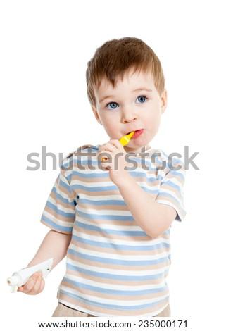 Child kid boy brushing teeth isolated - stock photo
