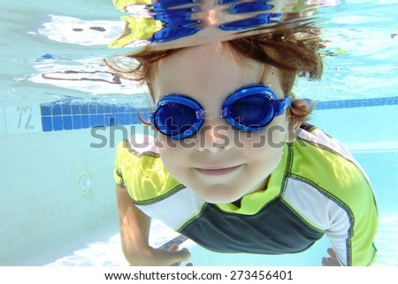 Child, kid, diving and swimming in pool underwater, summer or sports theme - stock photo