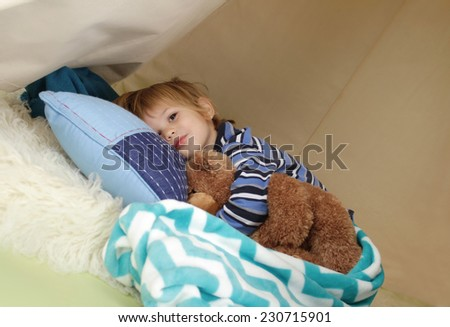 Child, kid, taking a nap, restin gin a play tent - stock photo