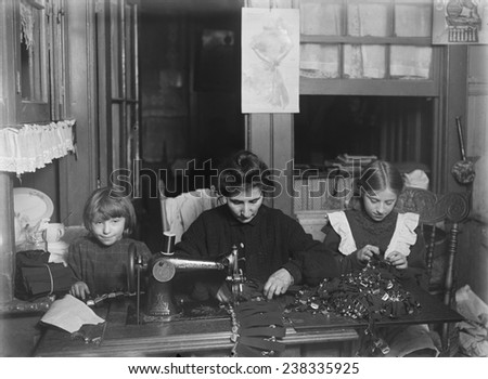 Child labor, making garters for Liberty Garter works, Mrs. Finkelstein, Bessie, age 13, Sophie, age 7. 127 Monroe Street, New York, photograph by Lewis Wickes Hine, January, 1908
